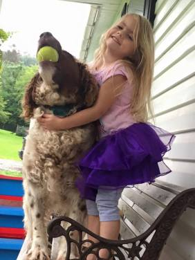 Lando with my niece. That dog will chase anything for as long as you'll throw it.