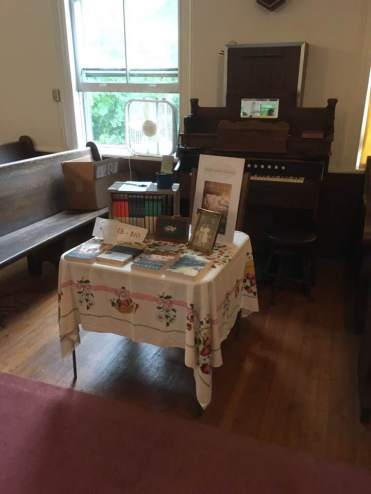 My book table was in front of the pump organ, which was PLAYED during Sunday's church service.